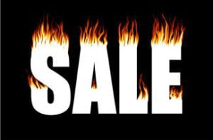 sale sign with flames